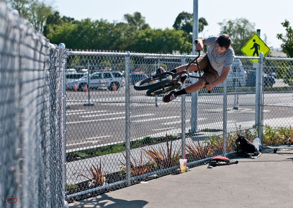 Aron Brewer banggin out a fence ride from the mini bowl lip , about 8 ft gap.