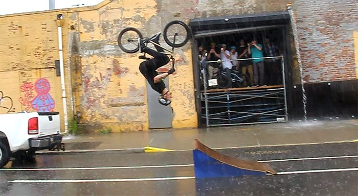 jason-phelan-bmx-backflip-pouring-rain-traffic-nyc